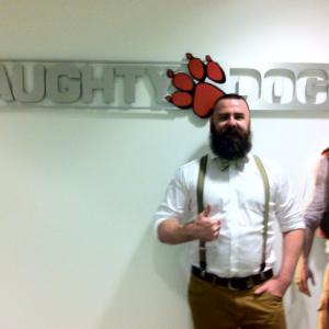 Boon Cotter posing in front of the Naughty Dog sign after he got the job