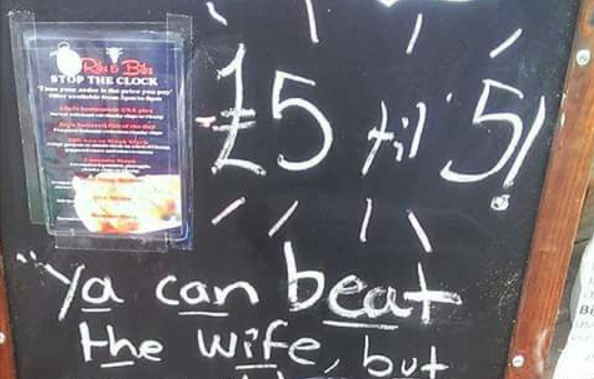 This Irish Restaurant bar sign jokes about domestic violence and beating yoru wife