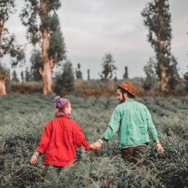 happy couple, couple walking in field,