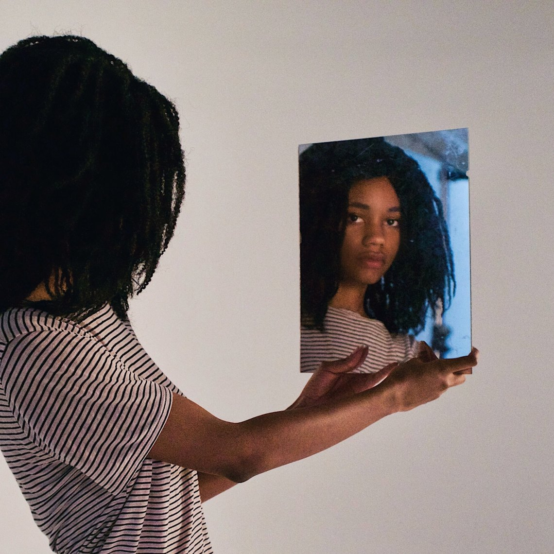 girl looking at self in mirror