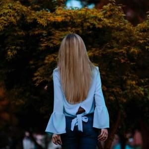 back of girl in garden