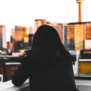girl looking out at city, abusive relationship