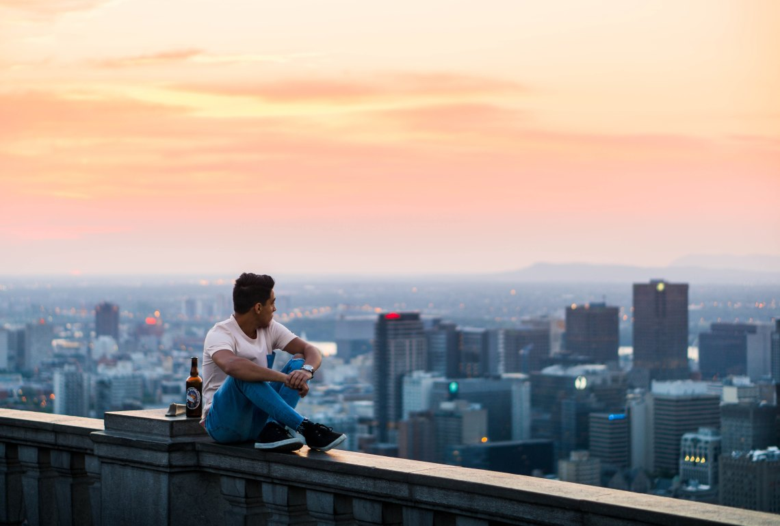 guy looking over city at sunset, endings, painful endings