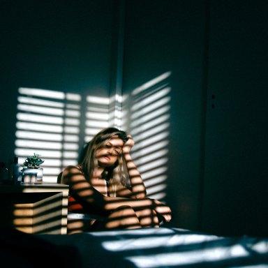 woman sitting in dark
