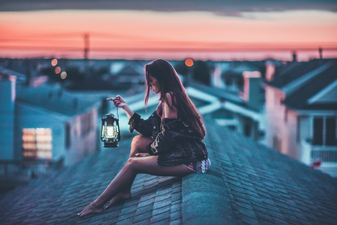girl on rooftop with vintage lamp