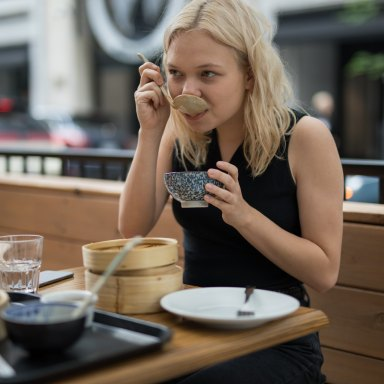 girl at restaurant eating chinese food