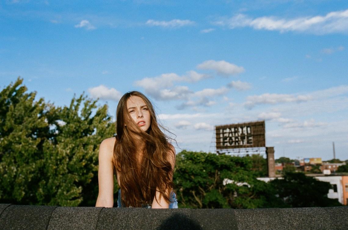 girl with long brown hair looking ahead