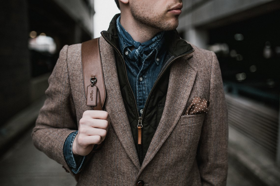 Man wearing nice clothes and a backpack