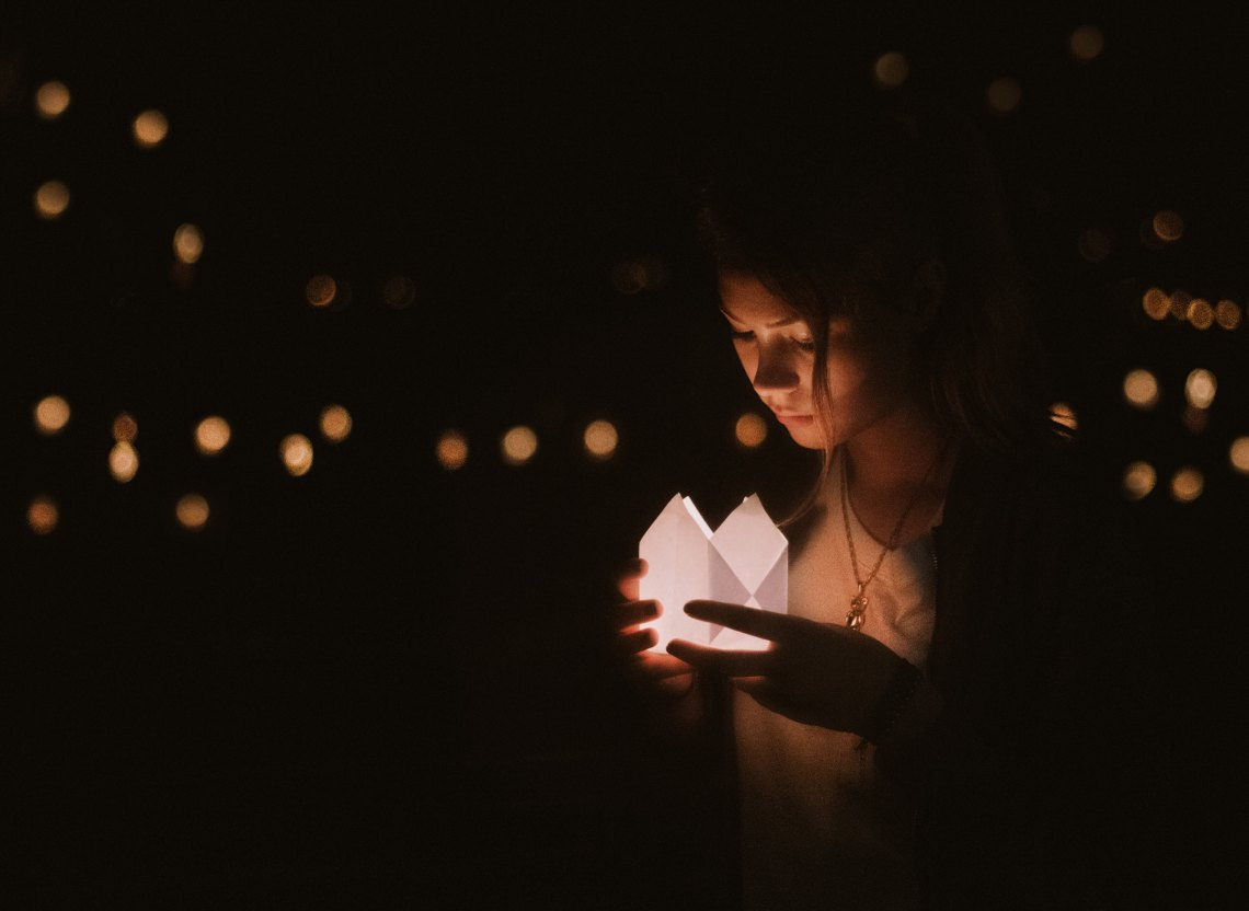 girl looking at box, dark, girl surrounded by lights, healing reminders, healing after abuse