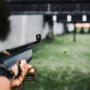 someone shooting a rifle at a shooting range
