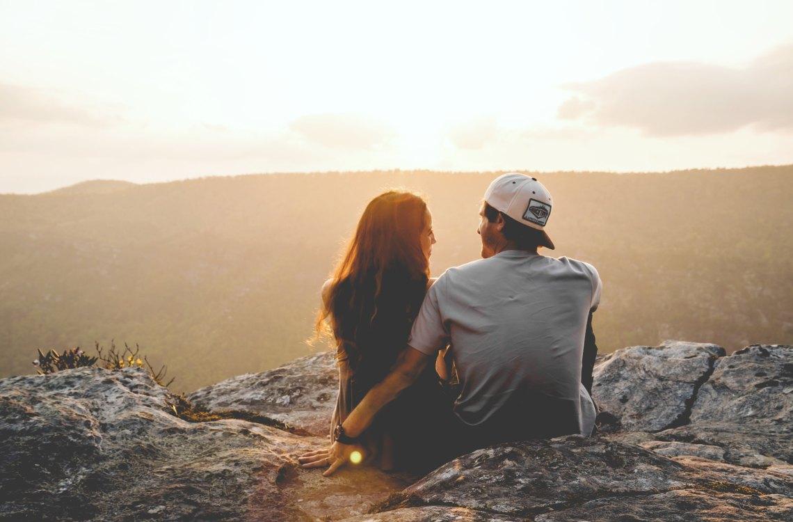 Couple sitting on mountain
