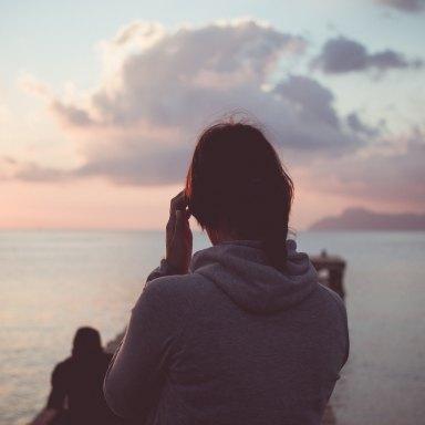 Girl staring at ocean
