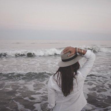 Woman standing in ocean