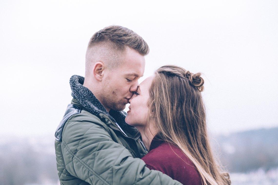 Guy kissing girl on forehead