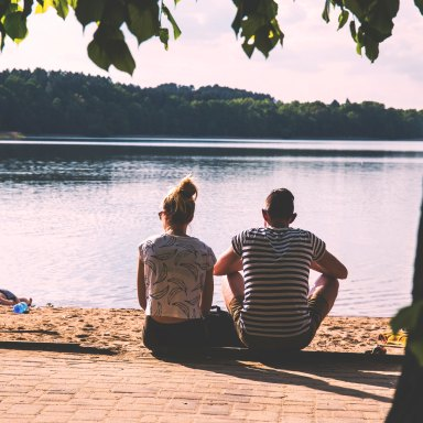 couple sitting by water