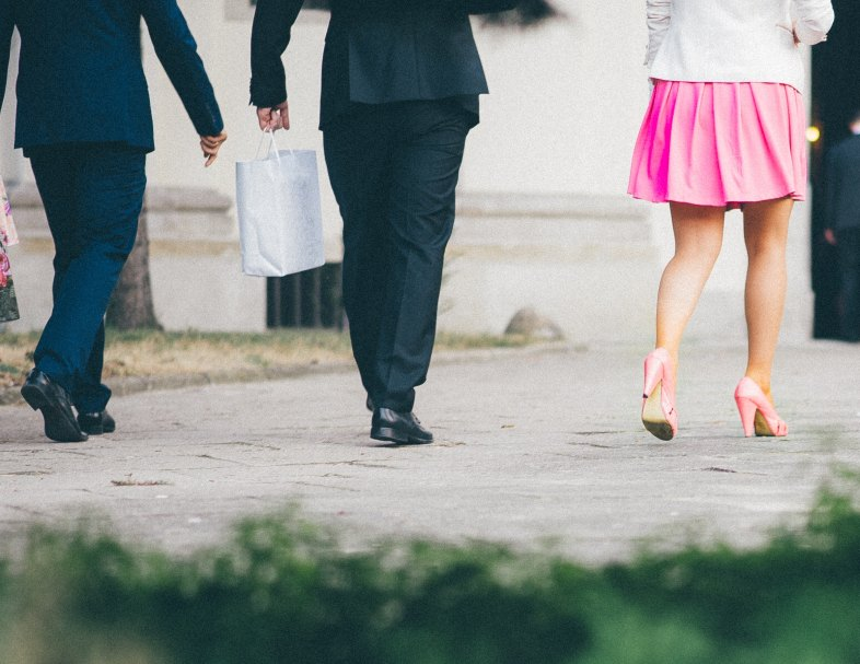 two men and a woman in professional wear