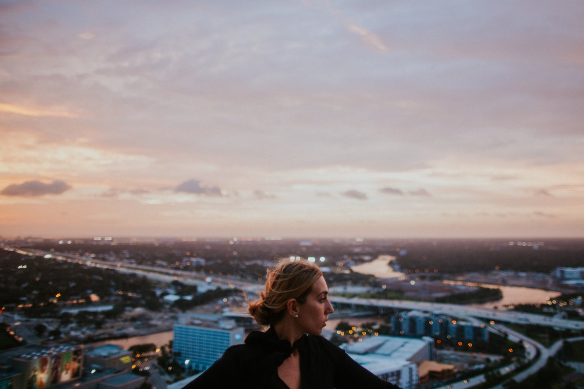 girl at sunset looking at city skyline, losing you, becoming whole