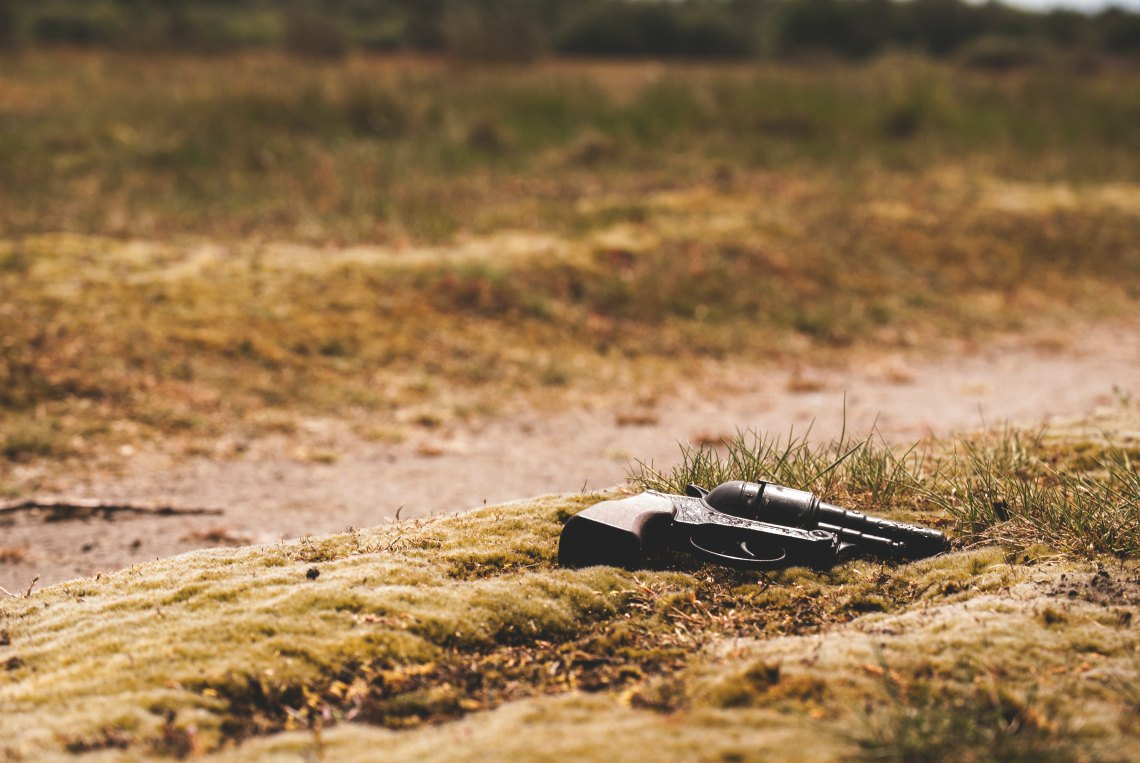 A single gun laying on the ground