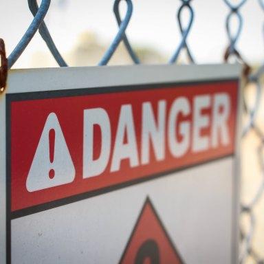 Danger sign on a fence