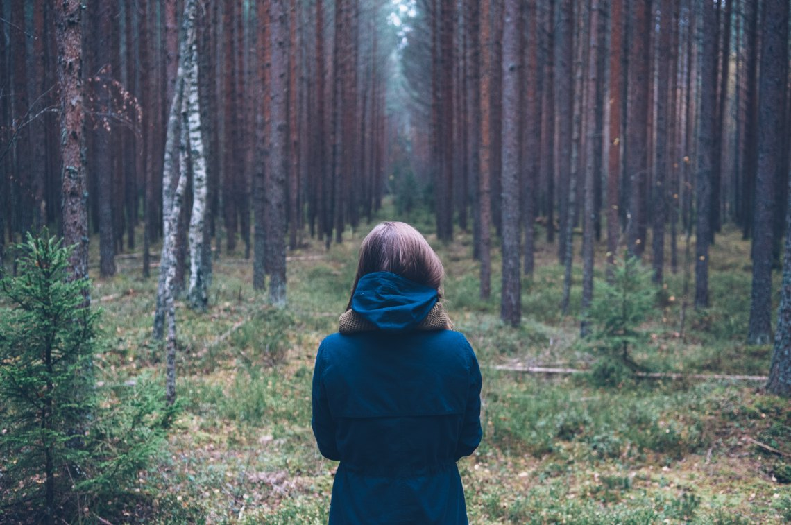 Woman in dark forest