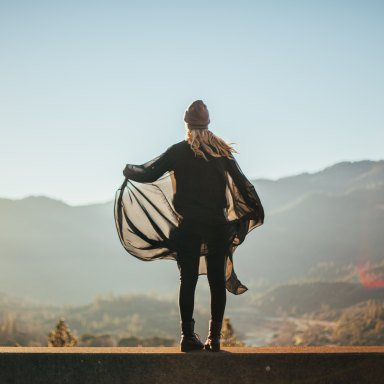 Woman standing over mountain ledge