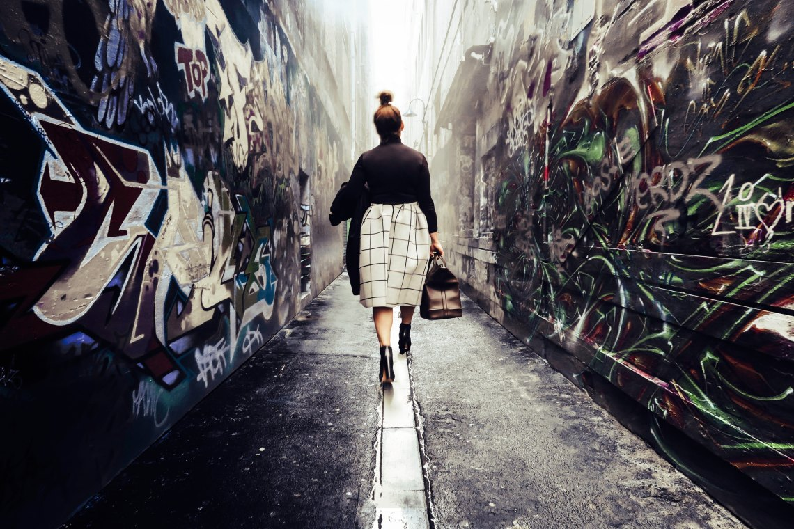 Professional woman in alley