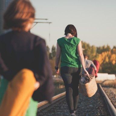 People walk across a bridge together