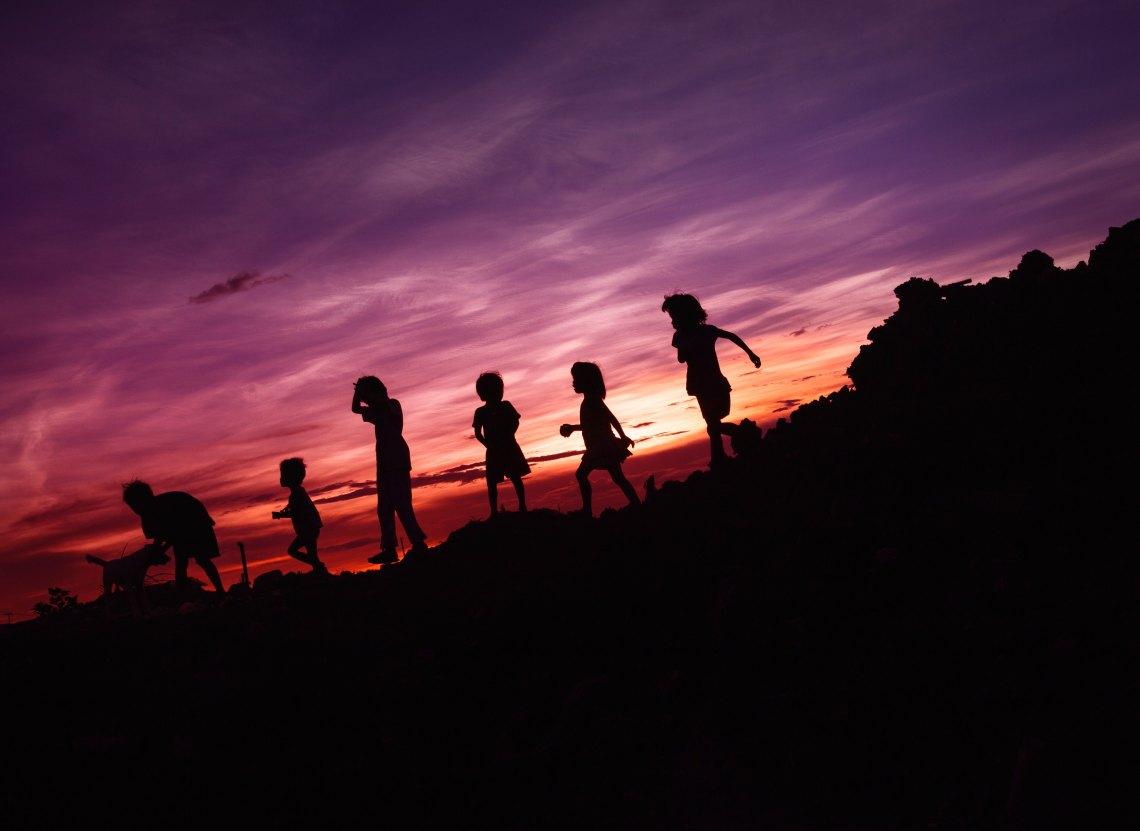 children running in the sunset