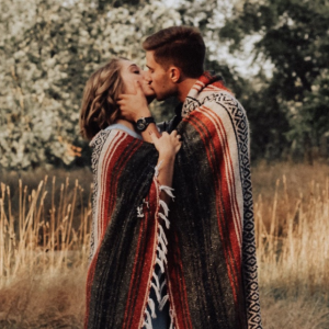 Couple kissing under blanket