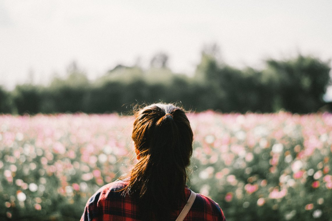 Woman standing in field of flowers