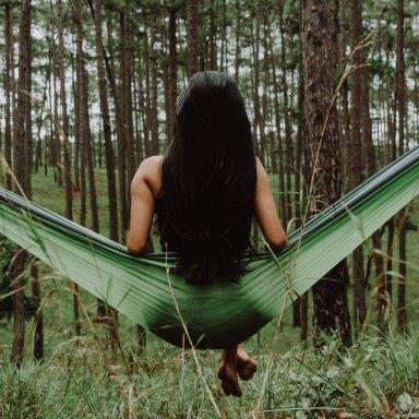 Woman in hammock in woods