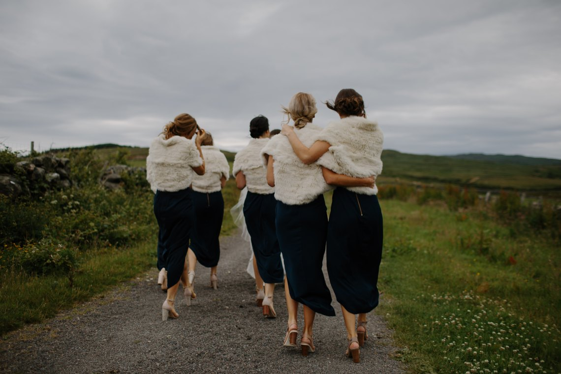 Women walk together down a road in solidatiry