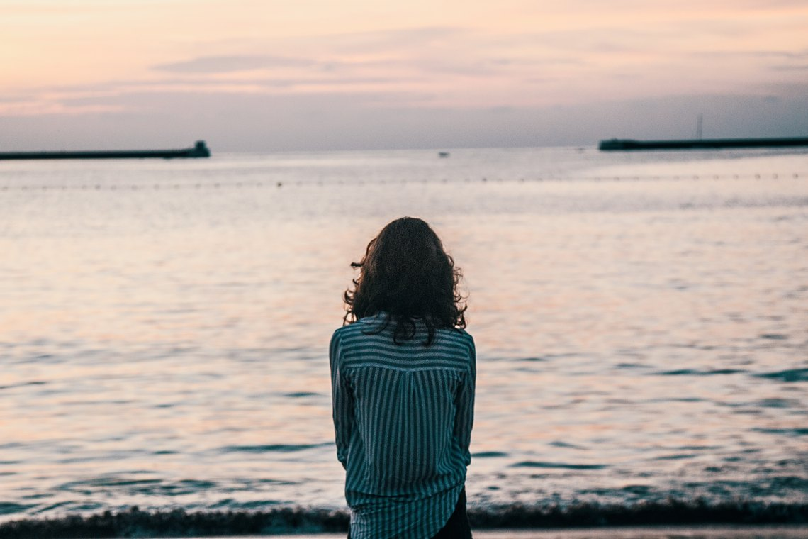 Sad woman by water