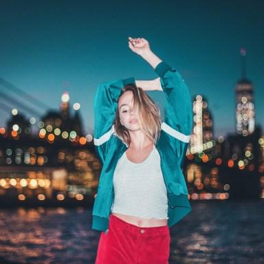 girl in front of city skyline