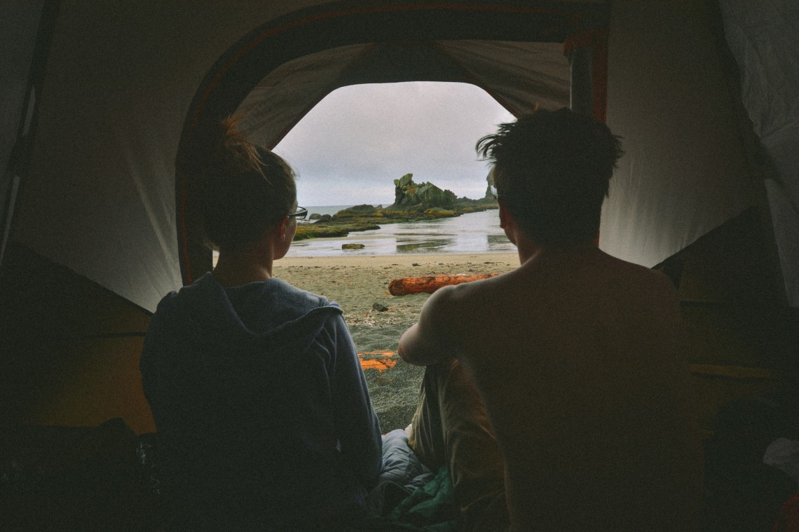 couple looking outside tent, couple in tent, narcissistic relationship, narcissistic partner, narcissistic signs to look out for