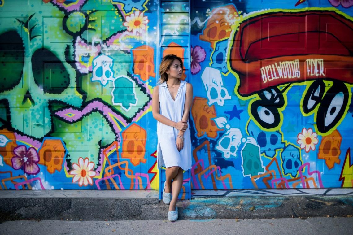girl standing by graffiti wall, sensitive, sensitive and strong