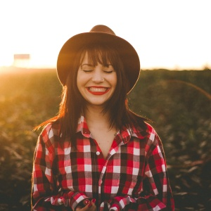 Woman smiling in flannel shirt
