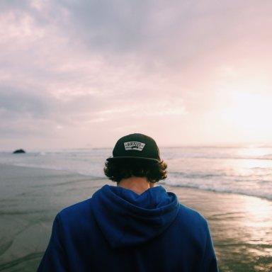 Guy standing over ocean