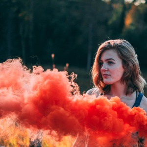girl with red smoke