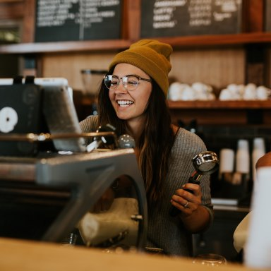 girl laughing coffee shop hat