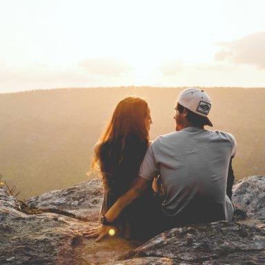 Couple hugging on mountaintop