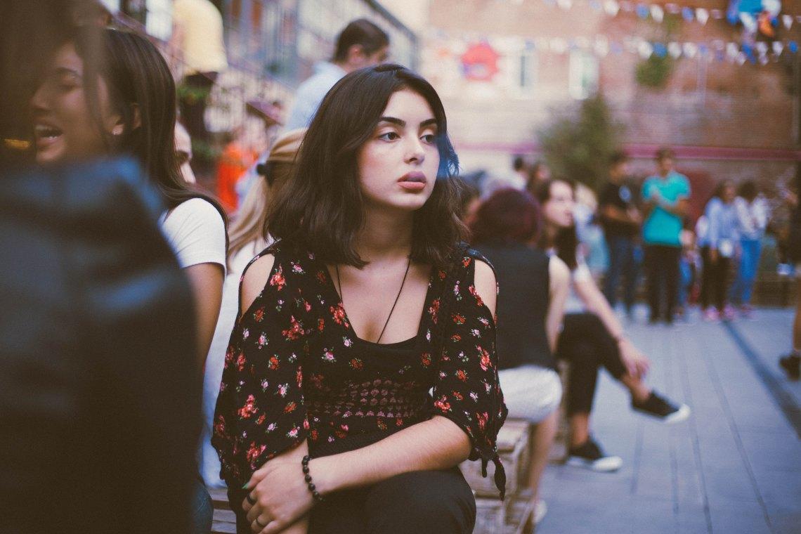 girl in crowd, sad girl, heartbreak, truth about heartbreak