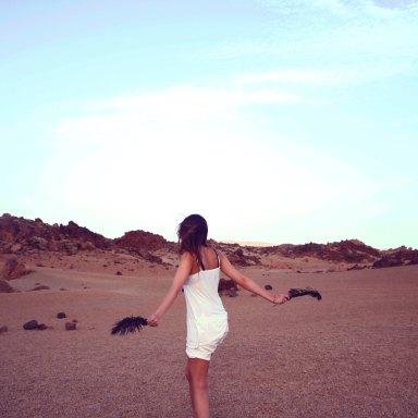 Girl dancing in desert