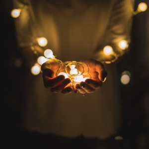 girl holding lights, little things, being thankful