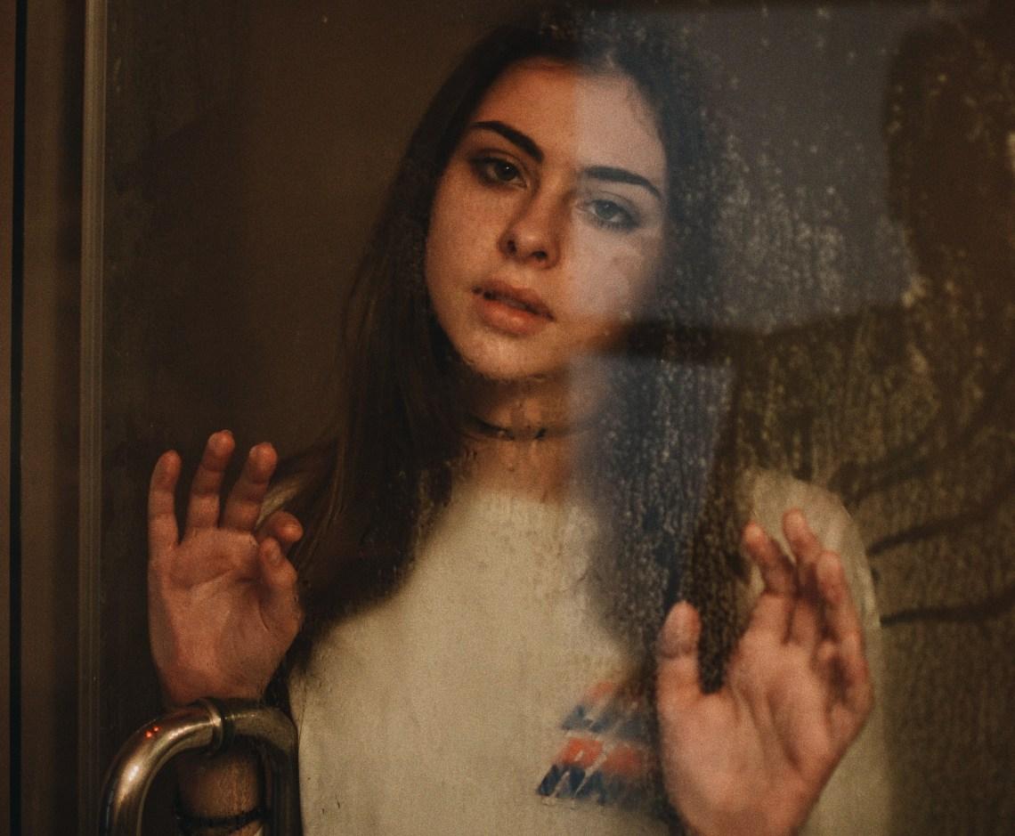 scared girl, hands against window, nervous girl