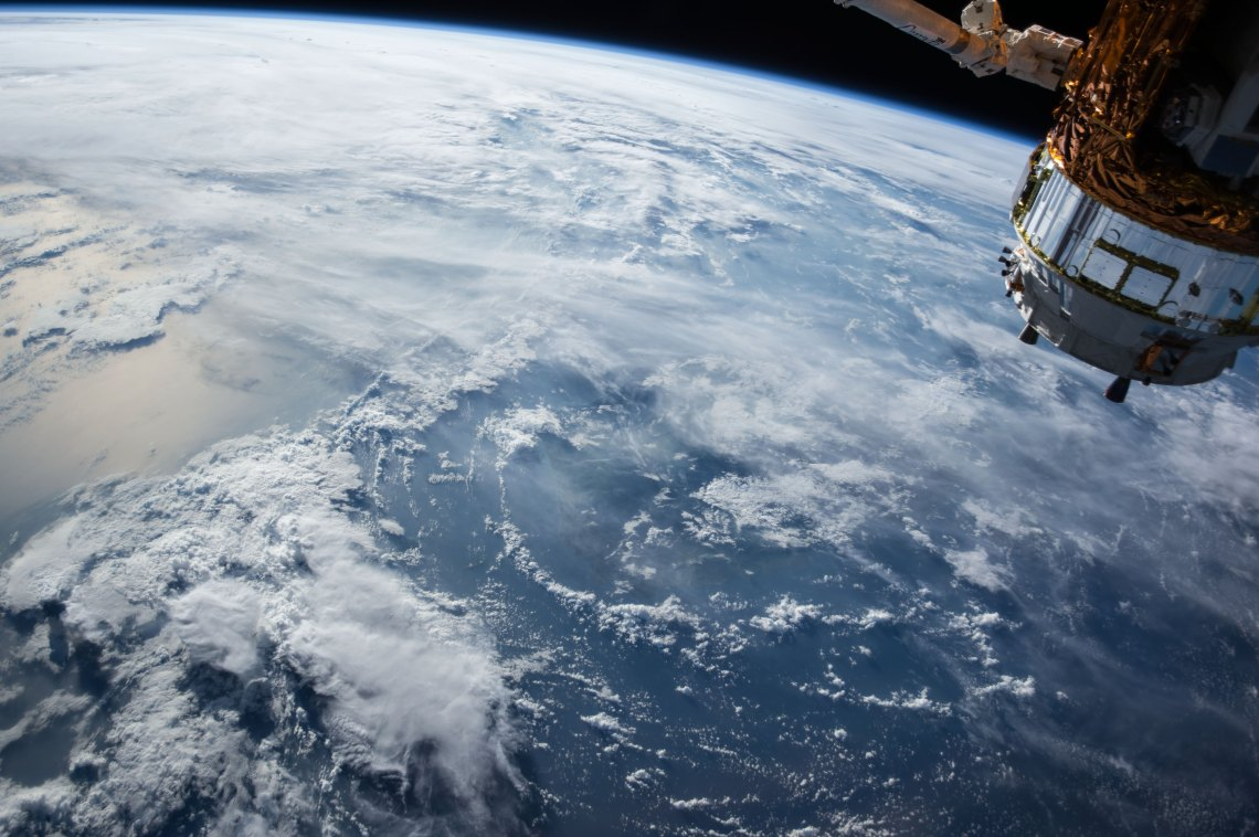 A picture of a satellite over the Earth