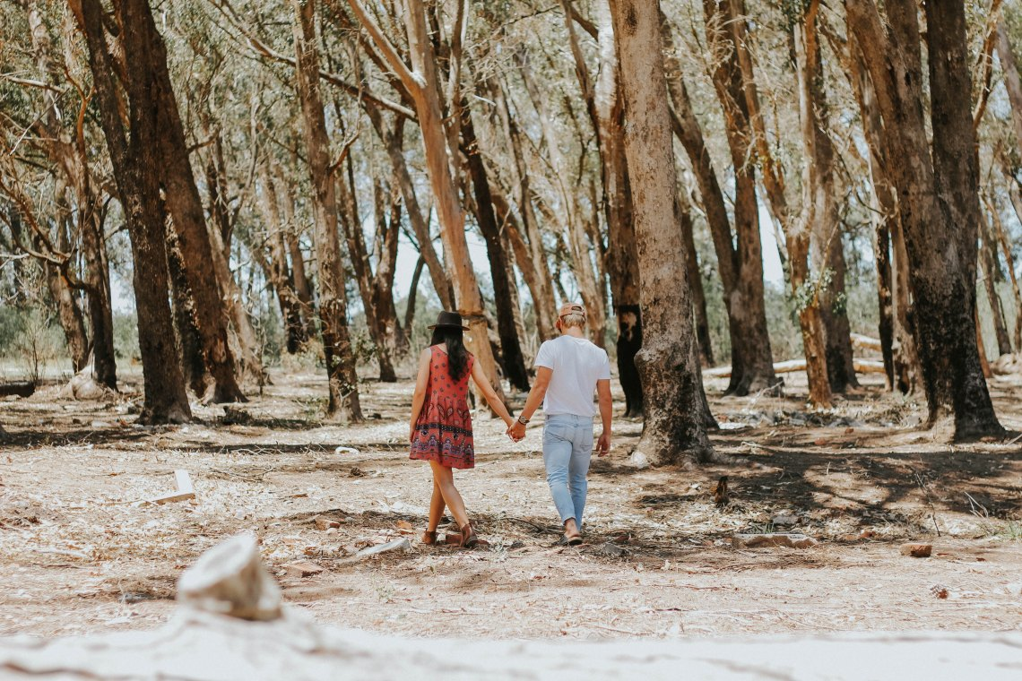 couple walking through forest, happy couple, based on the love languages, love languages