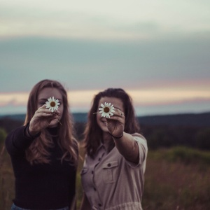 friends holding flowers