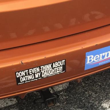 A sexist bumper sticker on a dad's car