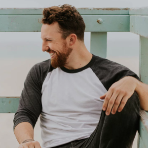 Guy laughing on dock
